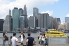 Admiring the Manhattan skyline from the Fulton Ferry Landing. Photo / Rob McFarland