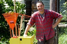 Justin Newcombe with his handy dandy gardening tool caddy. Photo / Dean Purcell