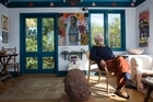 Dick Scott, historian and former journalist and communist, relaxes in his art-packed sunroom in Mt Eden. Photo / Paul Estcourt