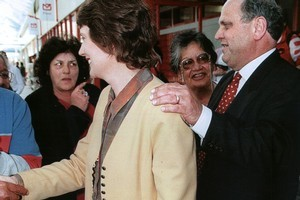 Mike Moore gets behind his party leader, Helen clark, on the campaign trail in 1996. Photo / Russell Smith