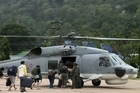 The Thai military has rescued hundreds of tourists stranded on southern resort islands by storms.