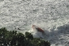A rescue boat hits a wave as it approaches one of the students. Photo / Supplied