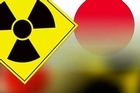 Emergency workers fled from one of the troubled Fukushima nuclear reactors after a huge increase in radioactivity was reported - a spike that officials later said was inaccurate.