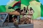Libyan rebels seized back two key oil complexes and pushed west toward Tripoli.