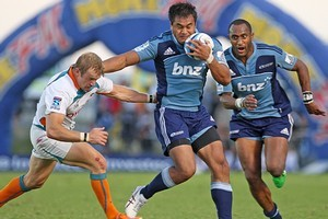 Isaia Toeava of the Blues fends off Sarel Pretorius of the Cheetahs. Photo / Getty Images