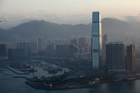 The International Commerce Centre (ICC) towers above other Hong Kong skyscrapers. Occupying the ICC's 102nd to 118st floors, the world's highest hotel - the Ritz-Carlton - has recently opened its doors. Photo / AFP