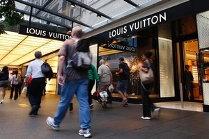 Pedestrians walk past the Gucci and Louis Vuitton stores on Queen Street, Auckland. Photo / Sarah Ivey