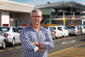 Mike Beauchamp at the taxi rank at Auckland Airport. Photo / Sarah Ivey