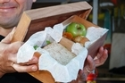Justin Newcombe shows off his smart and durable wooden lunchbox. Photo / Sarah Ivey