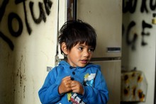 Tyrall West, 4, in the communal kitchen in Kotuku Lodge, where decay and rubbish are part of the scenery. Photo / Janna Dixon 