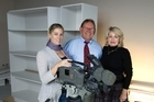 CTV staff Sacha Stevens, Rob Cope-Williams and Mary-Anne Jackson in what will be their new studio and with a camera they recovered from their earthquake and fire devastated building in Christchurch. Photo / Simon Baker