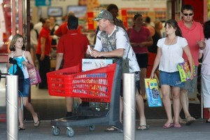 Shoppers at a Warehouse store in Albany, Auckland. Photo / Steven McNicholl