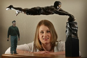 Artist Natalie Stamilla with her model of Michael Jones. The cardboard cut-out to the left is to indicate scale. Photo / Greg Bowker
