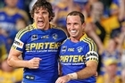 Joel Reddy and Luke Burt of the Eels celebrate winning the against North Queensland Cowboys. Photo / Getty Images