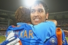 MS Dhoni and Sachin Tendulkar of India celebrate their teams win. Photo / Getty Images