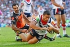 Anthony Minichiello of the Roosters scores. Photo / Getty Images