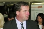 Policeman Martin Folan leaves the High Court acquitted of six assault charges. Photo / NZPA