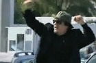 Under fire Libyan leader Muammar Gaddafi on TV in a defiant tour of his capital after fresh explosions shook Tripoli.