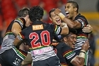 Petero Civoniceva (C) of the Panthers celebrates with Michael Jennings (R) and Timana Tahu (back) after scoring a try in the final seconds. Photo / Getty Images