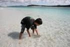 Waimana returns his Kahawai to the sea. Photo / Geoff Thomas