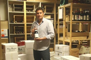 Simon Ward of Webb's with one of the bottles of wine that raised more than $47,000 for Christchurch. Photo / Supplied