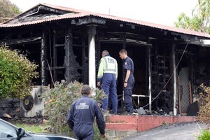 Fire safety officers and police believe the house fire was started by a laptop. Photo / Mark Mitchell