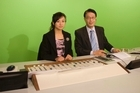 Wei Li (right) and co-host Gor Wang run through New 