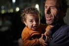 An evacuee and child prepare to disembark at the port in Benghazi, Libya. Photo / AP