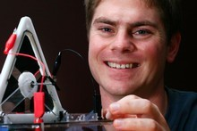 Thomas McKay demonstrates an artificial muscle motor. Photo / Martin Sykes
