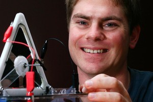 Thomas McKay demonstrates an artificial muscle motor. Photo / Martin Sykes