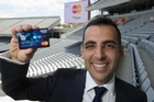 Alfred Naffah, country manager for Mastercard holds up the rugby debit card - the only one that will be allowed for purchases at RWC stadiums. Photo / Paul Estcourt