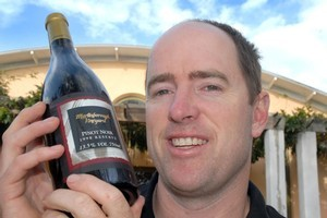 Winemaker Paul Mason celebrates with a rare bottle of the 1998 Reserve pinot noir. Photo / Supplied