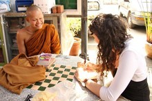 Monk Thon, of the Chedi Luang temple in Chiang Mai, Thailand, explains his lifestyle to tourists with near-perfect English. Photo / Joe Powers