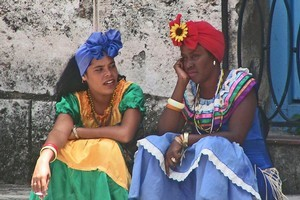 Women dressed in traditional outfits in the vibrant Cuban capital of Havana. Photo / Esther Sinke