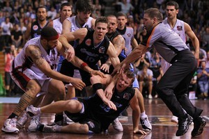 Gary Wilkinson falls to the ground during a scuffle in the Breakers' game three semifinal against the Wildcats. Photo / Getty Images