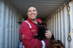 Andrew Leota and Douglas are reunited after the cat's adventure to Adelaide inside a shipping container. Photo / APN