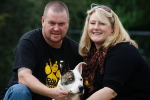 Shane and Kirsty Wooding from Auckland, with Torsha the deaf dog from the SPCA. Photo / Christine Cornege