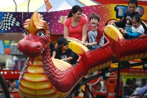 Families enjoy the rides at the Royal Easter Show held at the ASB showgrounds in Auckland. Photo / Steven McNicholl