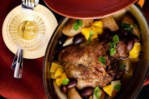 Slow cooked lamb with olives, oregano and orange. Photo / Babiche Martens