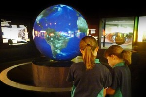 The Magic Planet display features a touch screen that lets users change the globe's surface from Earth to other planets. Photo / Stardome Observatory