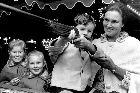 At the Easter Show, the girls played the laughing clowns, and threw darts at balloons - but in the Jury family, the shooting gallery was for the boys. Photo / NZ Herald
