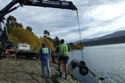 The van is winched from Lake Dunstan. Photo / Otago Daily Times