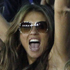 Elizabeth Hurley, center, cheers a boundary by Rajasthan Royals captain Shane Warne. Photo / AP