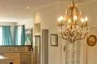 A chandelier in the dining room adds opulence. Photo / Your Home & Garden
