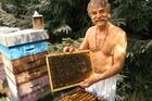 Beekeeper Yvon Achard has some unusual methods. Photo / Supplied