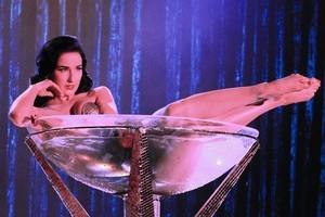 Dita Von Teese splashes around in her giant martini glass on CSI. Photo / Supplied