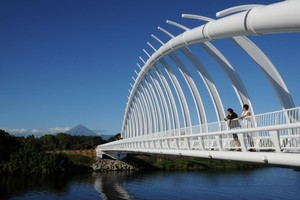 Te Rewa Rewa Bridge frames a distant Mt Taranaki. Photo / Liz Light