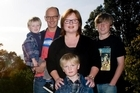 Michael Holmes and Kay McFarlane on Mt Albert Domain with their sons Oscar, Samuel and Tom. Photo / Dean Purcell