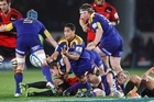 Aaron Smith of the Highlanders gets his pass away in the match against the Crusaders on Saturday. Photo / Getty Images