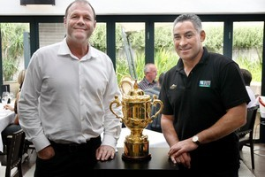 A.J. Whetton (left) and Frank Bruce show off the Webb Ellis Cup at Cibo restaurant in Parnell. Photo / Steven McNicholl